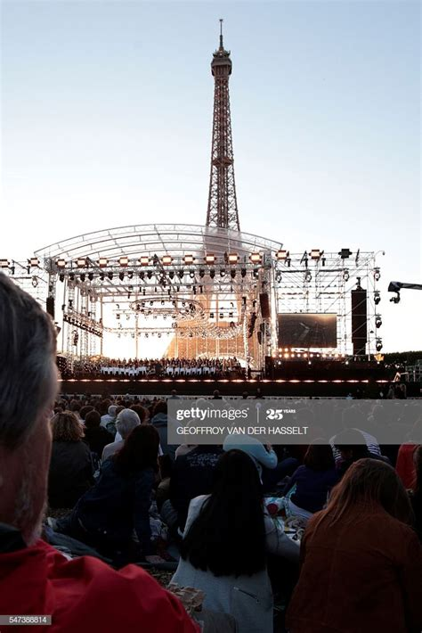 People attend a concert in front of the Eiffel Tower in