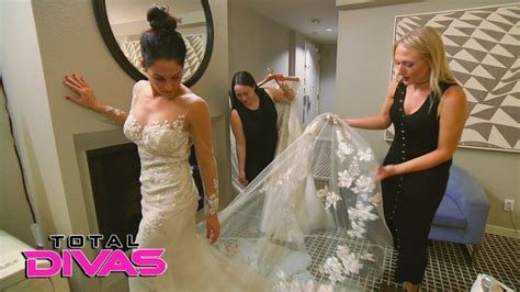 Nikki Bella tries on wedding dresses for the first time