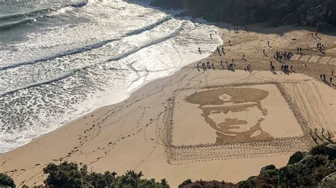 Portraits in the sand: artwork honours The Fallen on